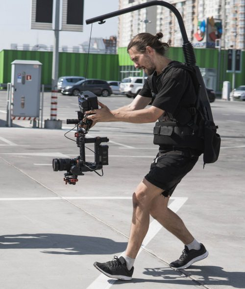 Image of our staff at Dallas Elite Video shoowing some footage out in a parking lot.